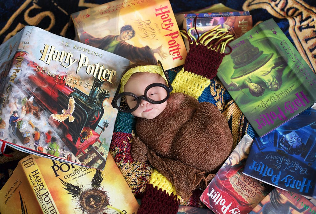 Harry Potter fans, baby girl in Harry Potter books with wizard glasses