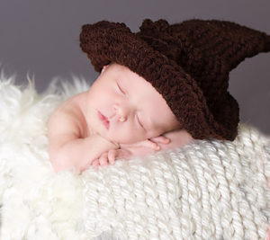 newborn girl with Harry Potter wizard hat