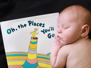 newborn baby on stomach sleeping on Dr. Seuss book