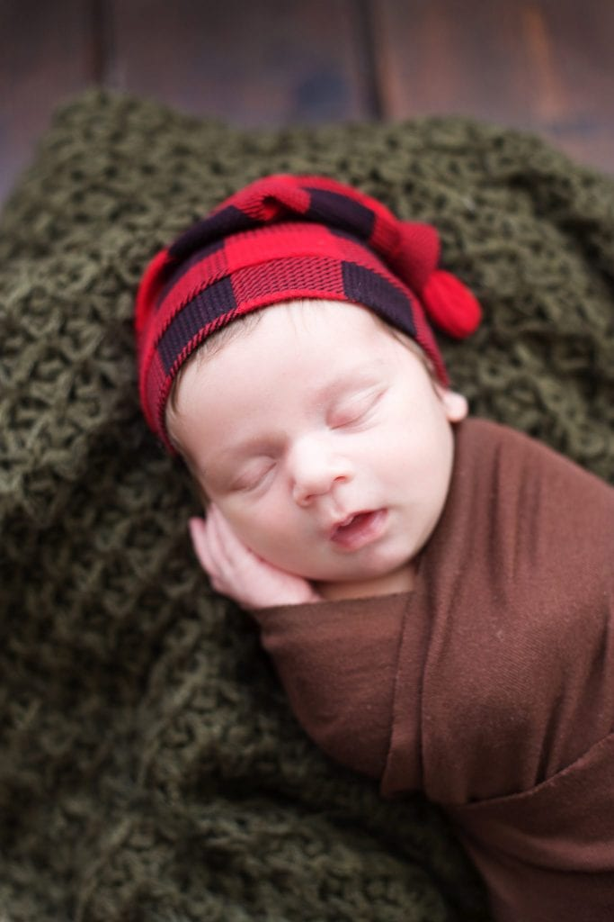 Newborn Photo Session, newborn brown wrap, plaid red hat, forest green blanket,