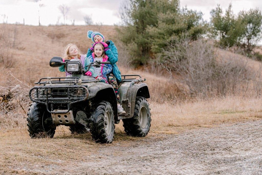 girls on 4-wheeler, coats on
