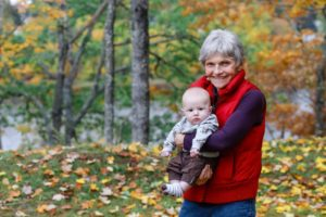 grandmother with her newborn grandson in the fall