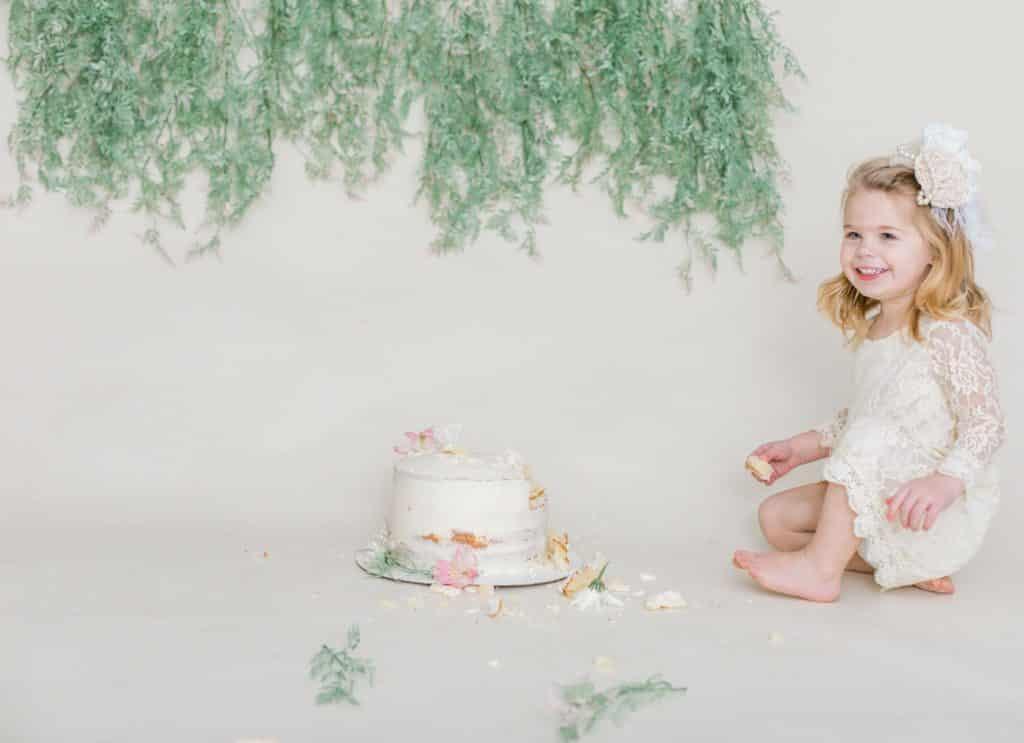 One year girl eating cake