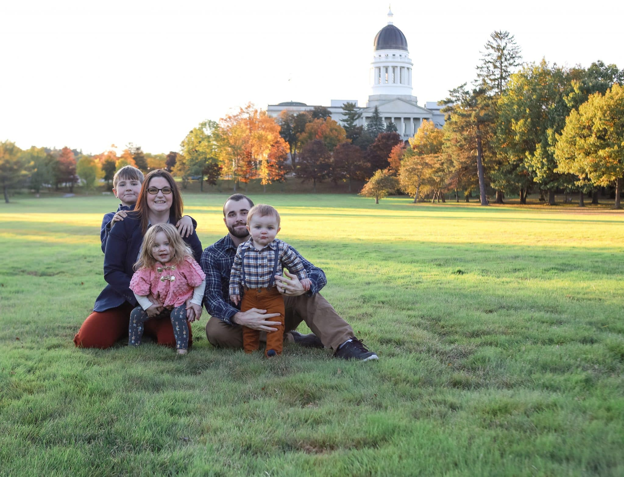 family photo in front of the state capitol in augusta,maine