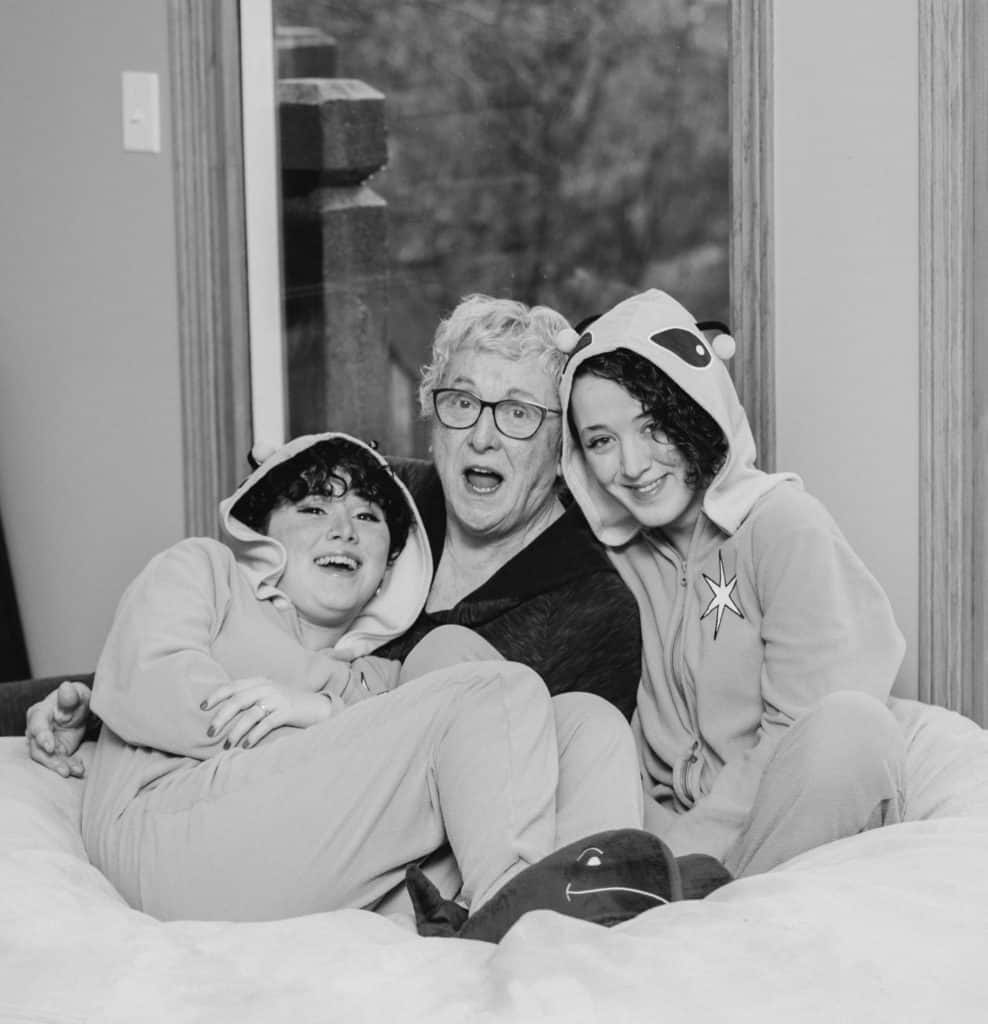 grandmother and granddaughters sitting on the bean bag in black and white