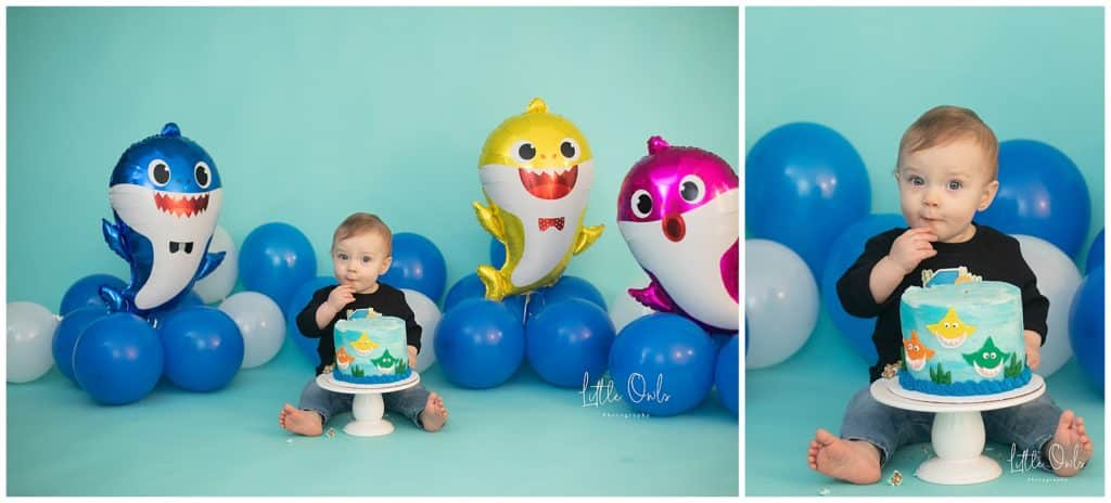 one year baby eating baby shark cake for one year cake smash session