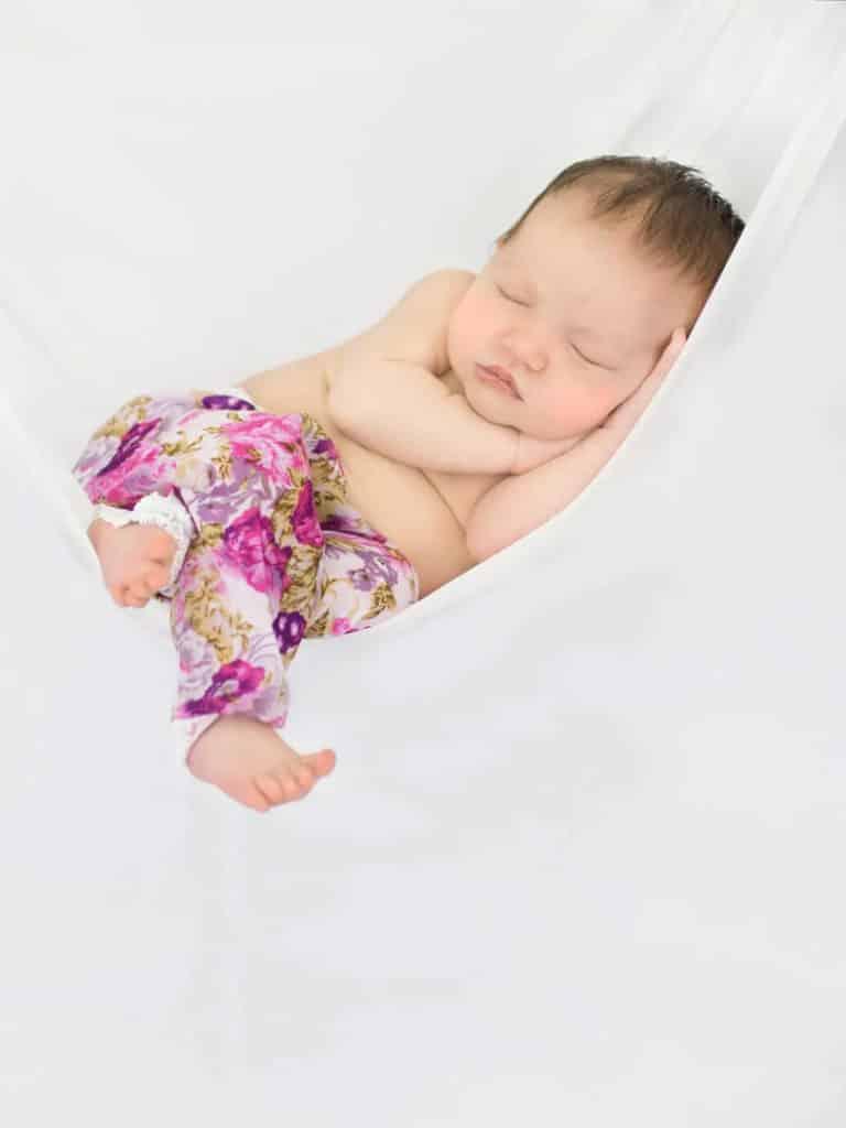 baby photographed sleeping in hammock