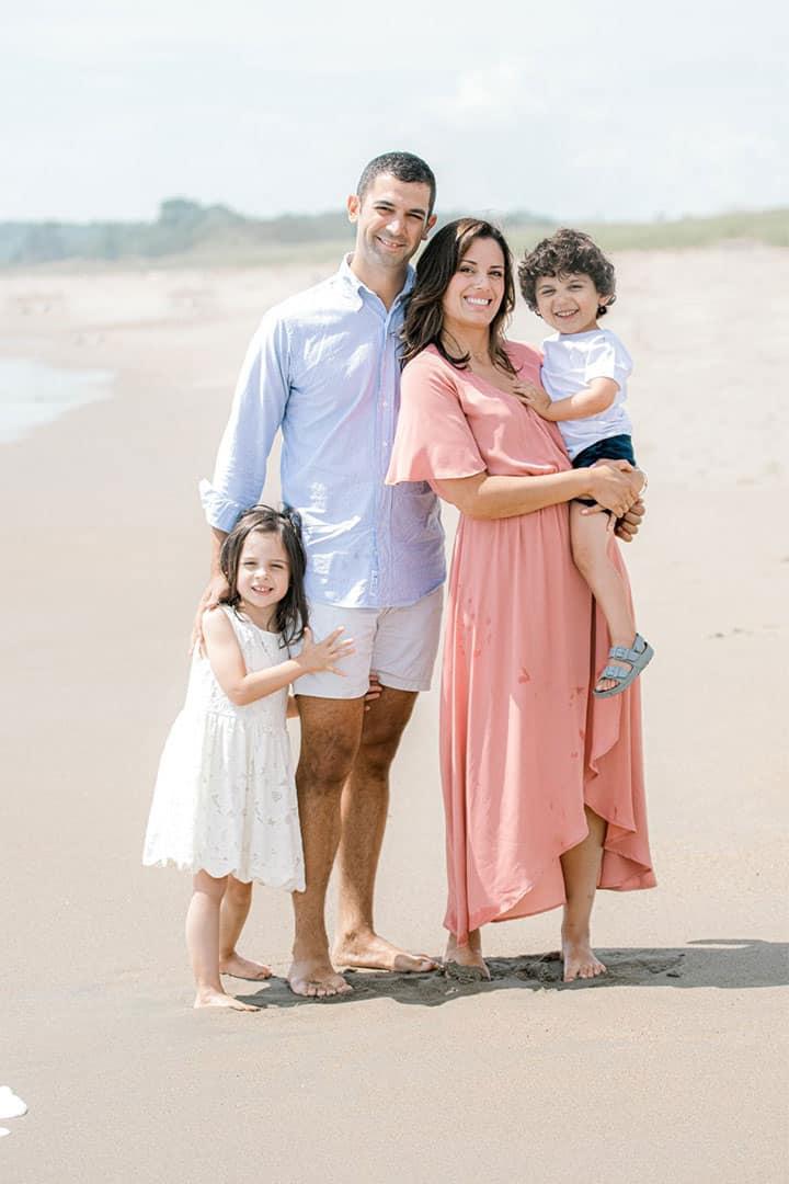 family photo taken on a maine beach