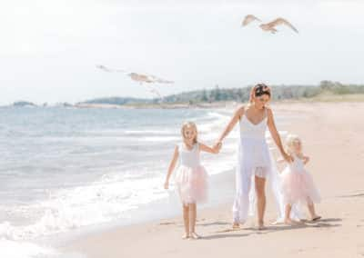 mother and daughters on maine beach