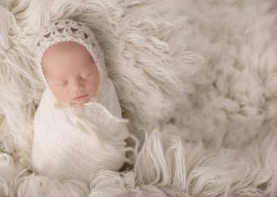 newborn bundled up in cozy blanket