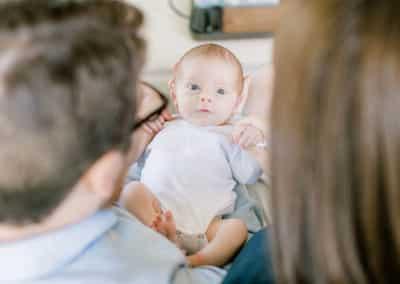 newborn looking at parents
