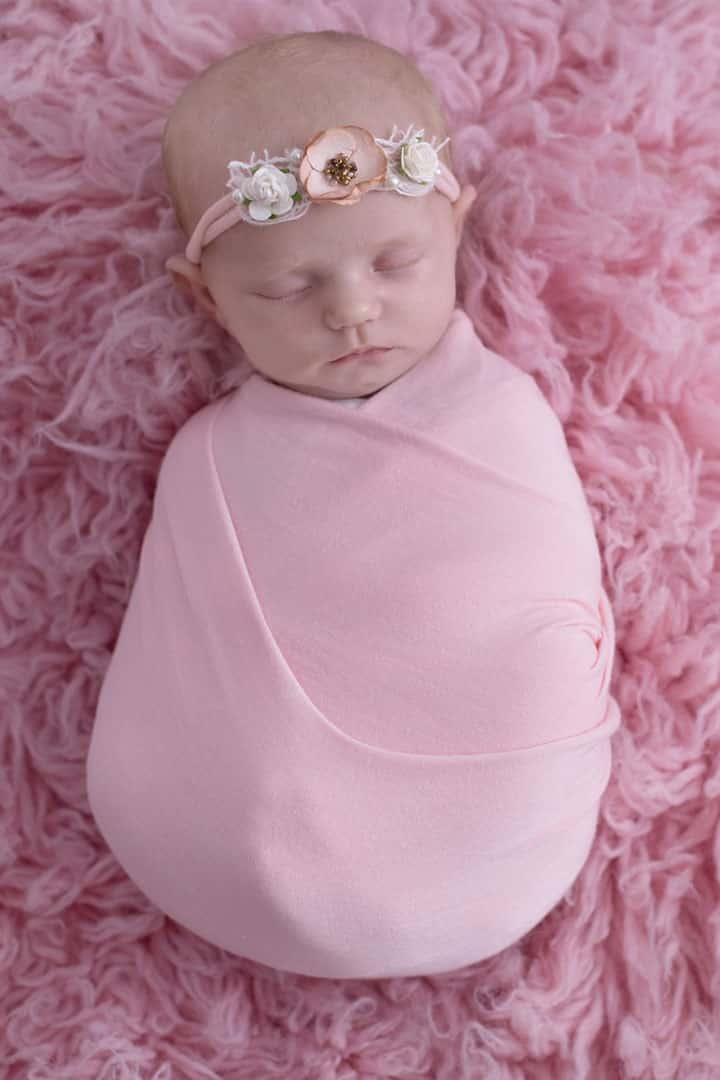 newborn flower headband wrapped in blanket
