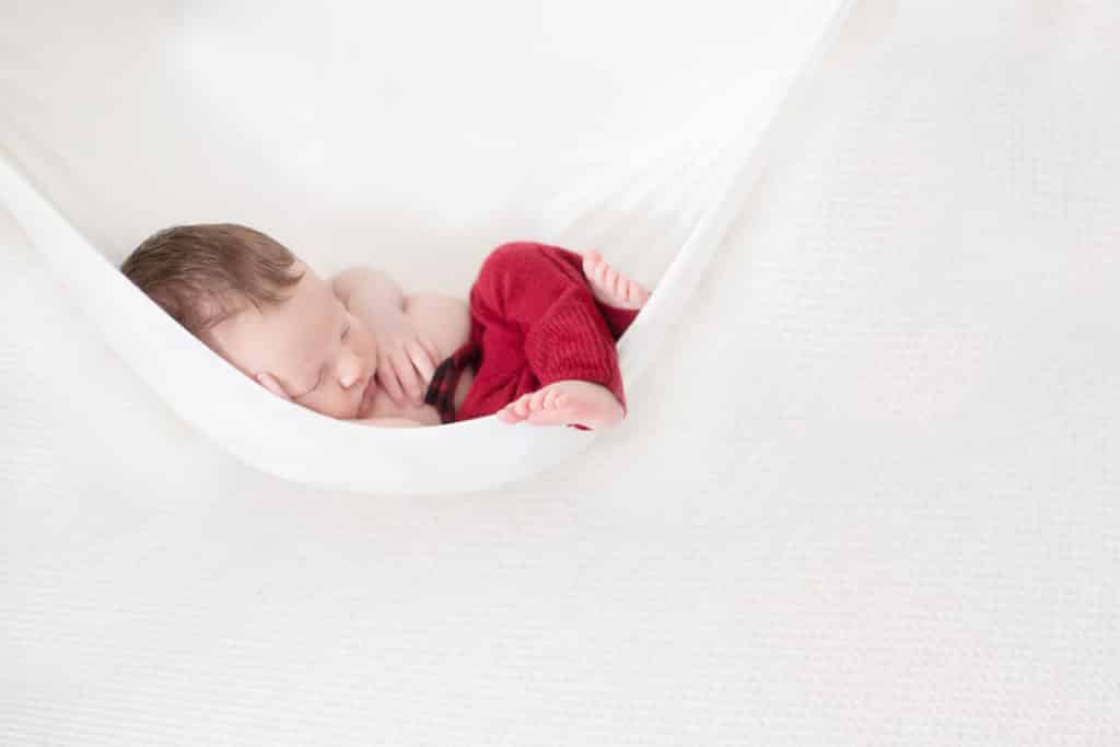 sleepy baby in hammock