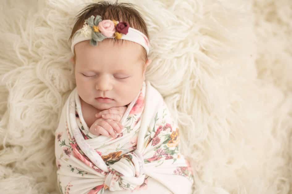 baby photographer in maine, wrapped newborn, floral prints, newborn girl in augusta maine studio