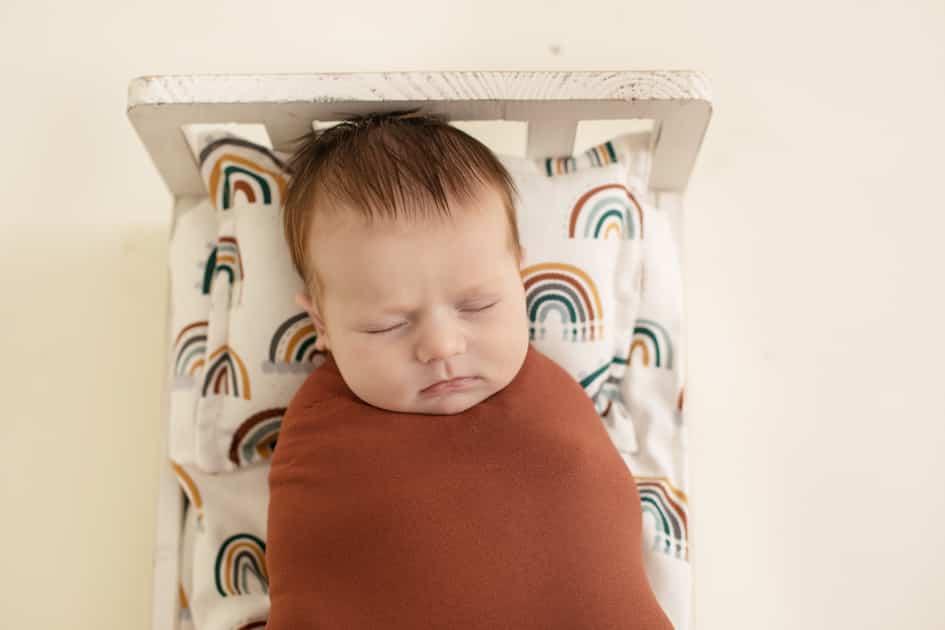 wrapped newborn, rainbow baby