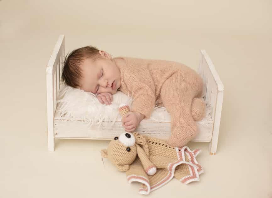posed newborn girl in crib, augusta maine studio newborn