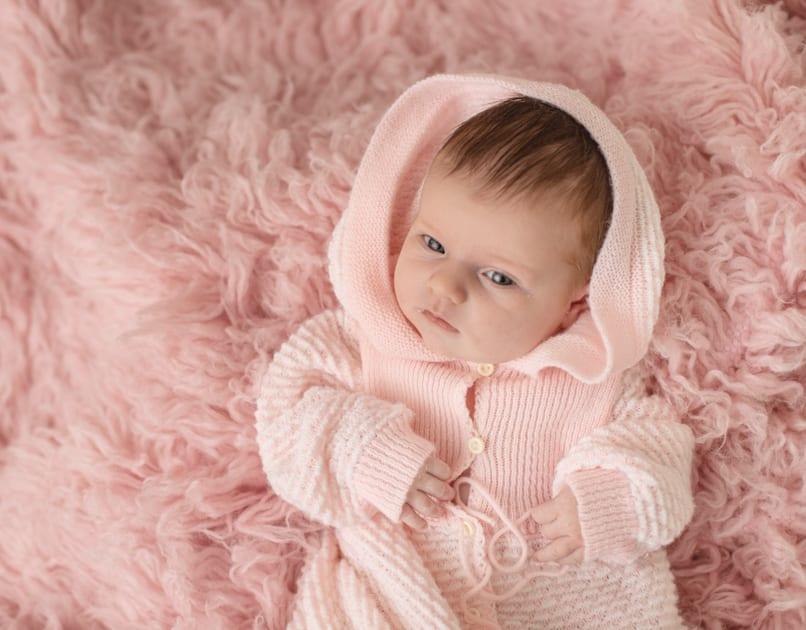 baby photographer in maine, awake newborn girl, newborn girl in romper, augusta maine studio